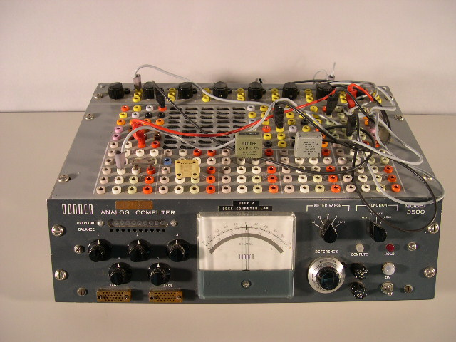 Front and top view of the Donner 3500 analog computer.  The wires (called patchcords) were used to program the computer; imagine substituting that wiring process for the modern keyboard.