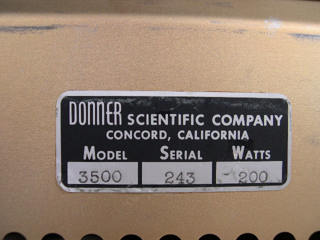 Closeup of the manufacturer's tag that includes the serial number.  You can also clearly see the company's name.  Later versions of this classic analog computer display the name Systron-Donner after the companies merged in 1960.