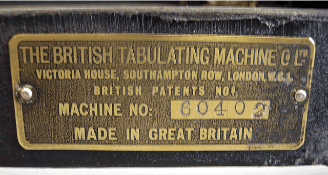 Closeup of the manufacturer's tag showing serial number of this British Tabulating Machine Company Type 001 mechanical keypunch (card punch). This manufacturer's nameplate on this rare keypunch helps us date the keypunch and place it in the timeline of computer history.
