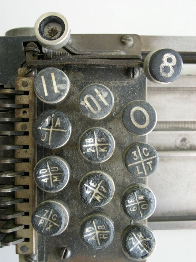 Closeup of the keypad of the British Tabulating Machine Company Type 001 mechanical keypunch (card punch); note how each key has four sections. This rare keypunch was an important part of computer history.