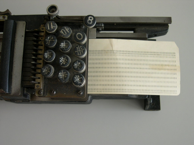 Is this how to load a card into the British Tabulating Machine Company's Type 001 mechanical keypunch (card punch)?  NO, NO, NO!! Cards should be loaded from the left and removed from the right once the holes have been punched.